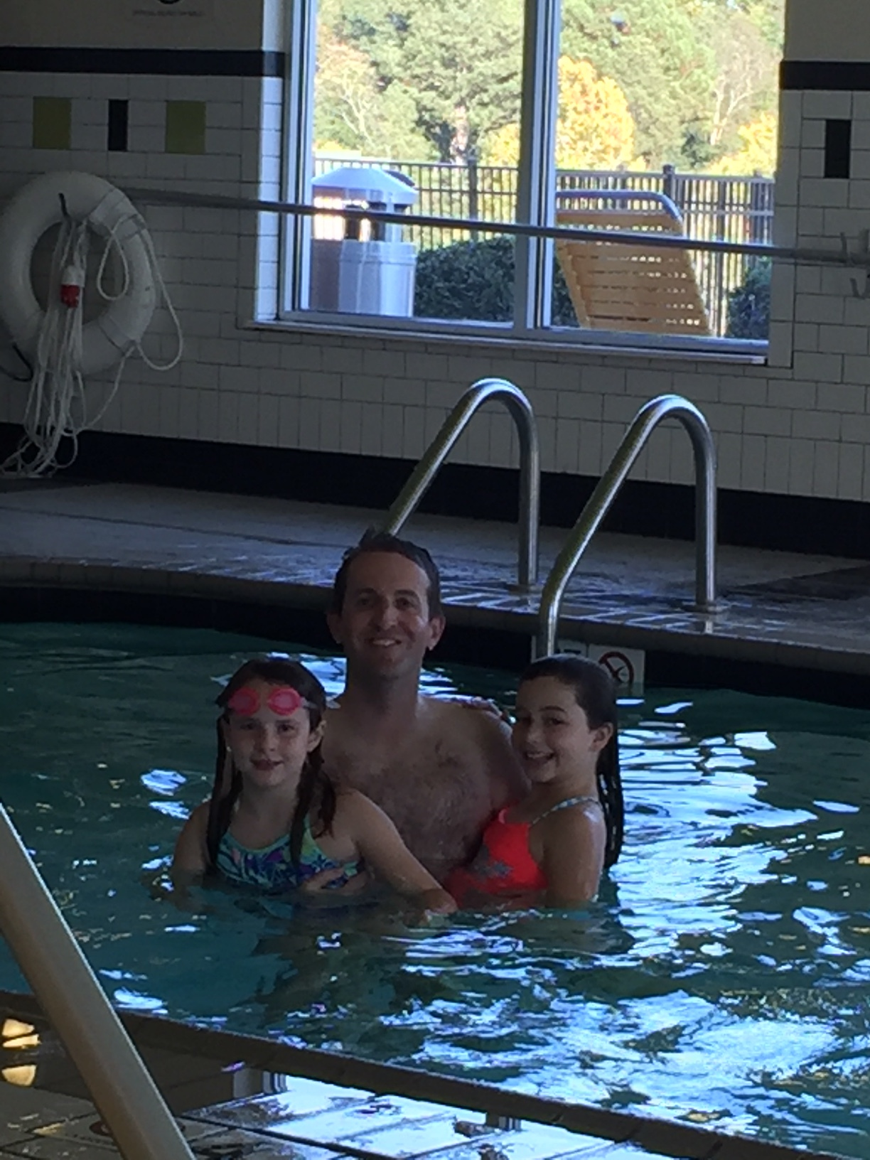 Taking advantage of the hotel pool! Mommy supervised from the side :)