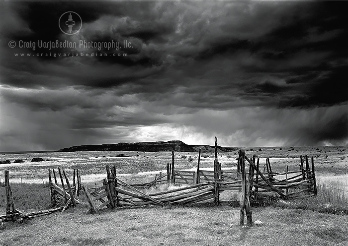 Old Corral and Approaching Storm, Antelope Flats, Ghost Ranch, New Mexico  2005.  Photograph by ©Craig Varjabedian