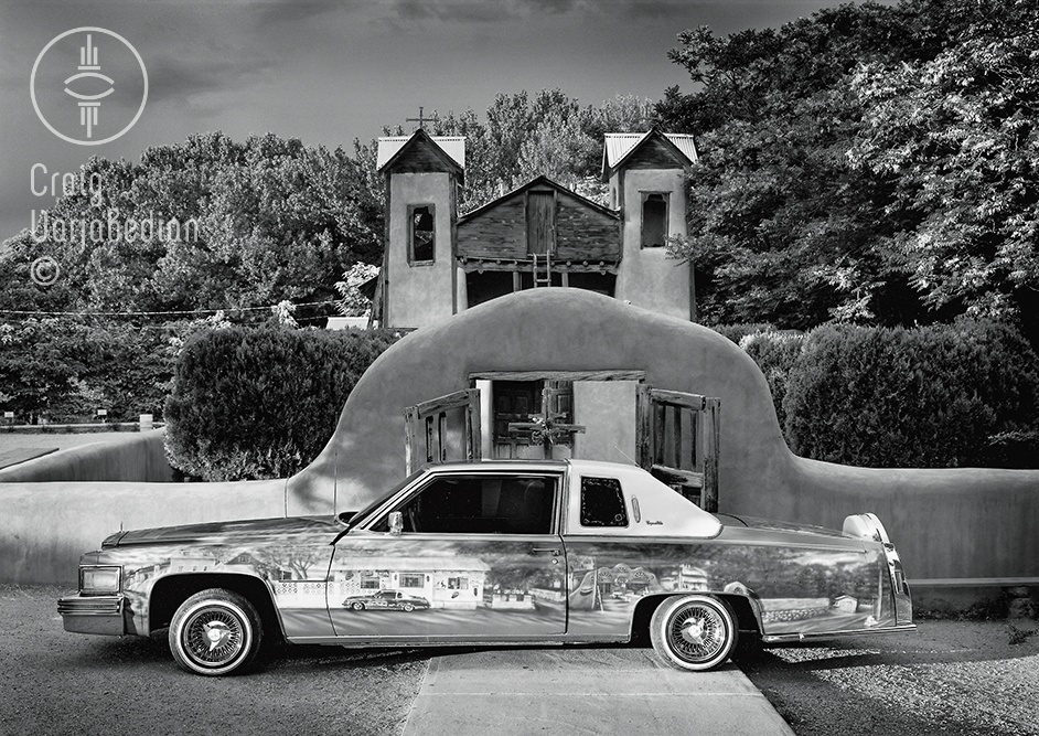 A Lowrider automobile photographed in front of a small New Mexico mission church