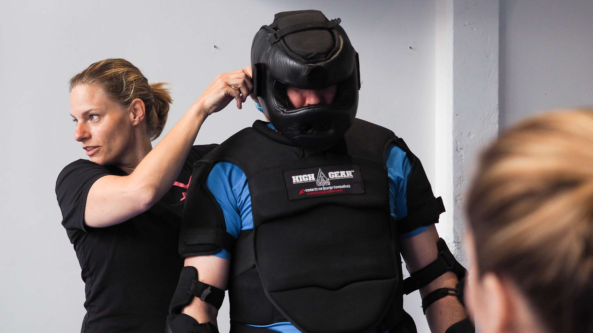 """Chief Trainer Synthia Stoffer prepping the """"man in pak"""""""