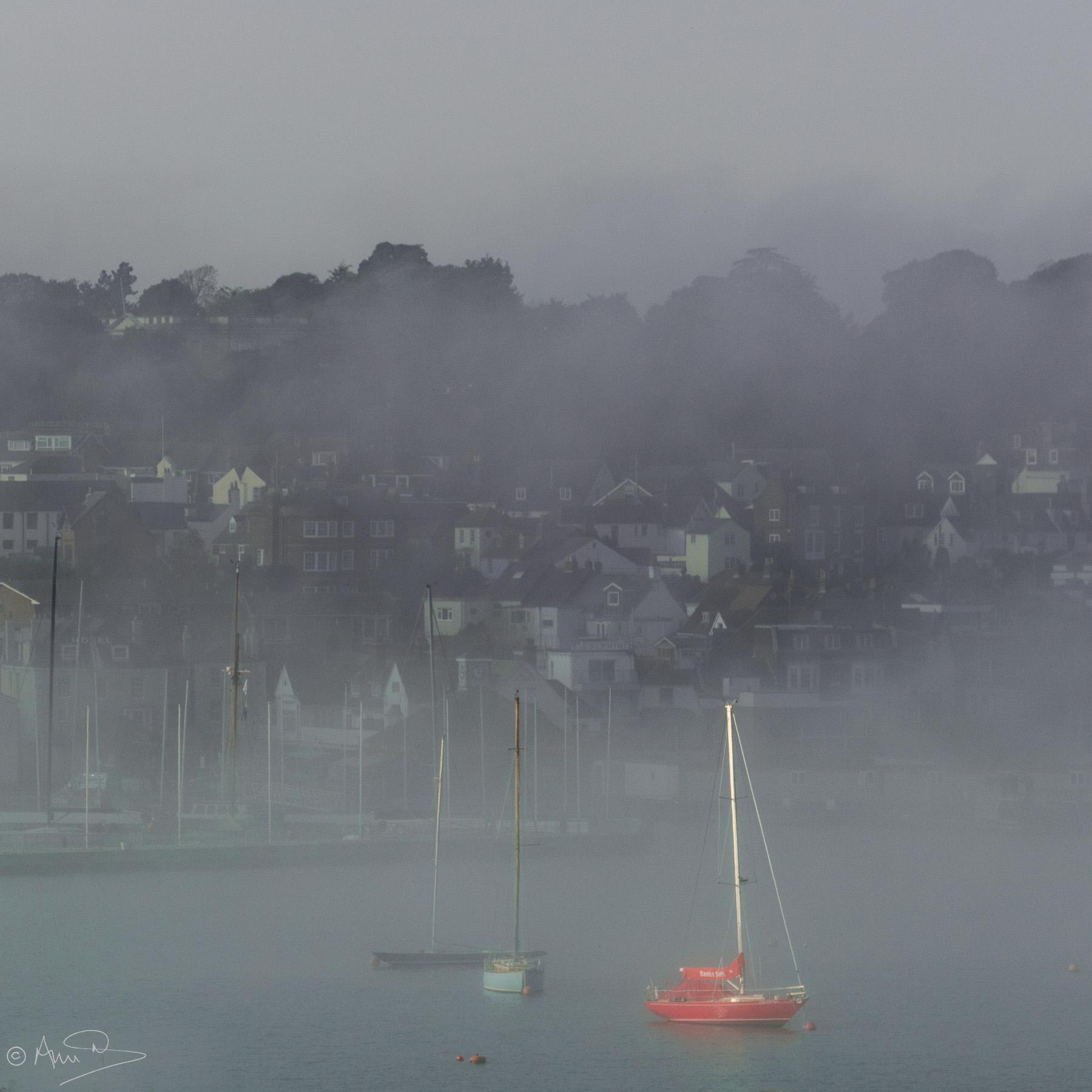 red boat in mist