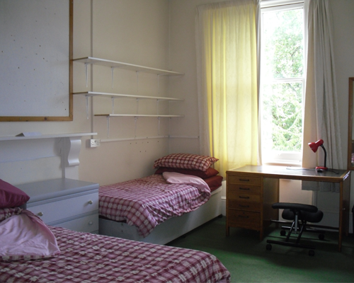 Twin unit room overlooking the garden, containing two single beds,two desks,two wardrobes and a vanity unit. The room also has an adjoining private kitchen.