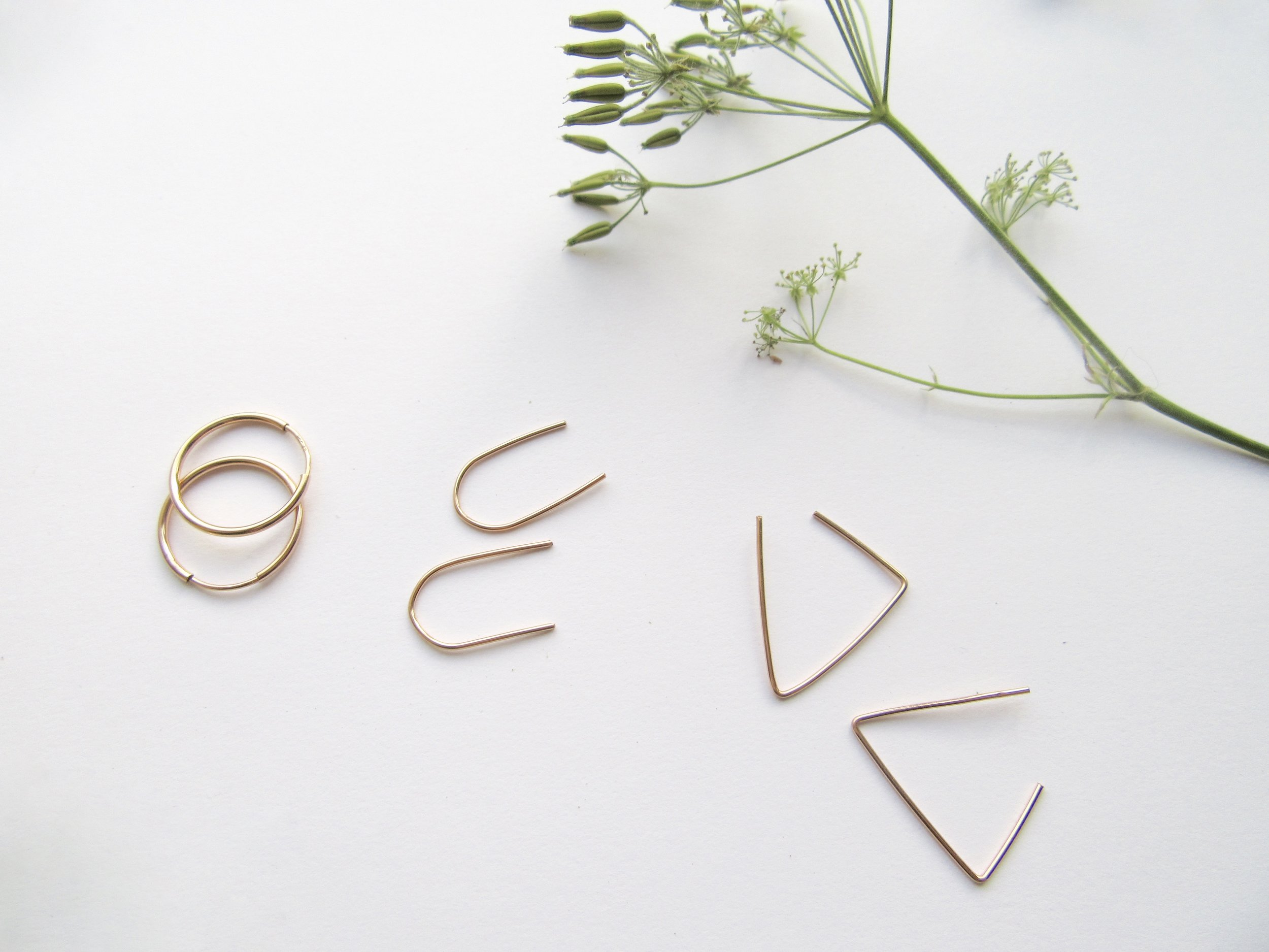 Left to right:  Rose gold sleepers ,  rose gold arc earrings ,  rose gold   triangle threaders