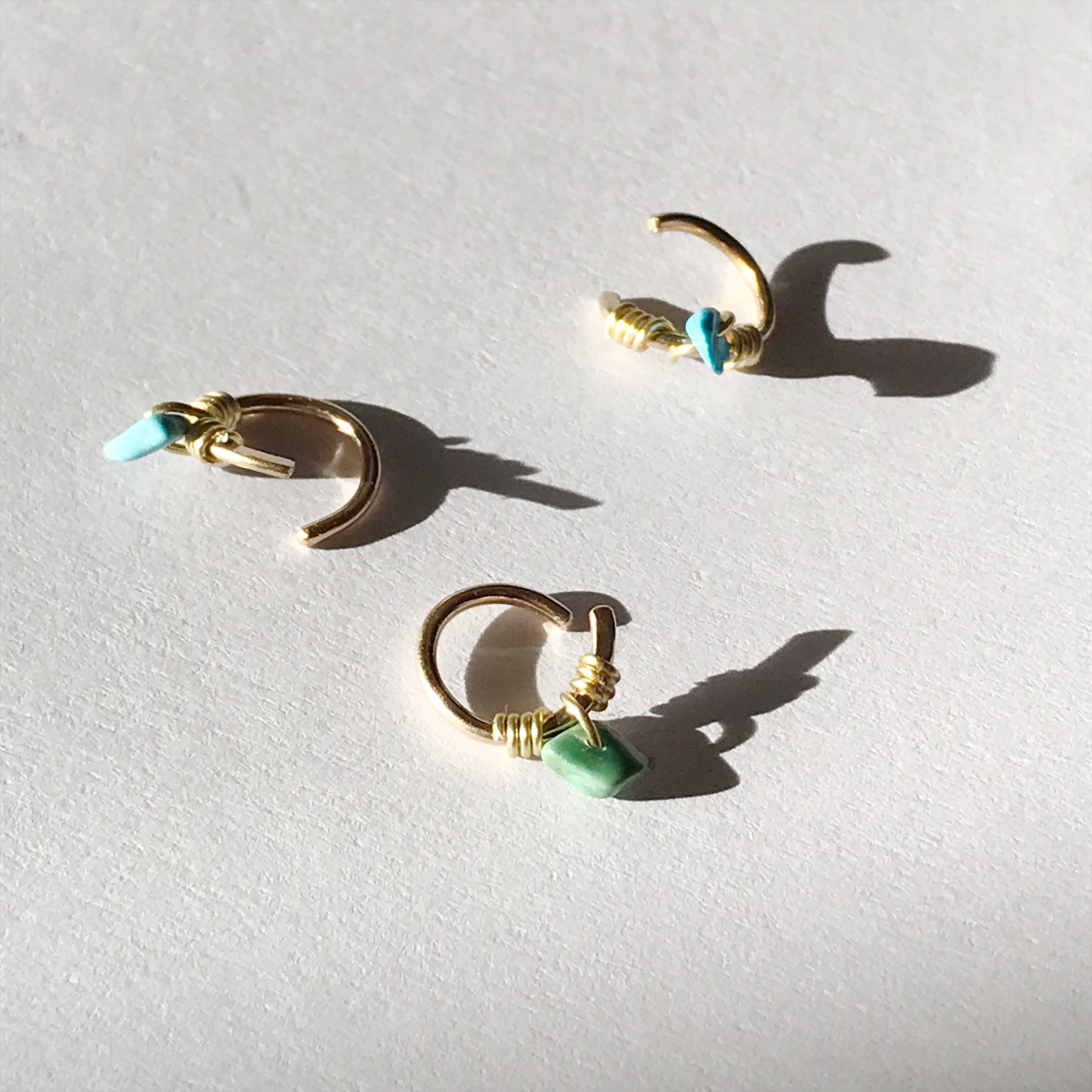 Turquoise cartilage hoops available in 8mm and 10mm diameters. 14K Gold fill. 20ga and 18ga.