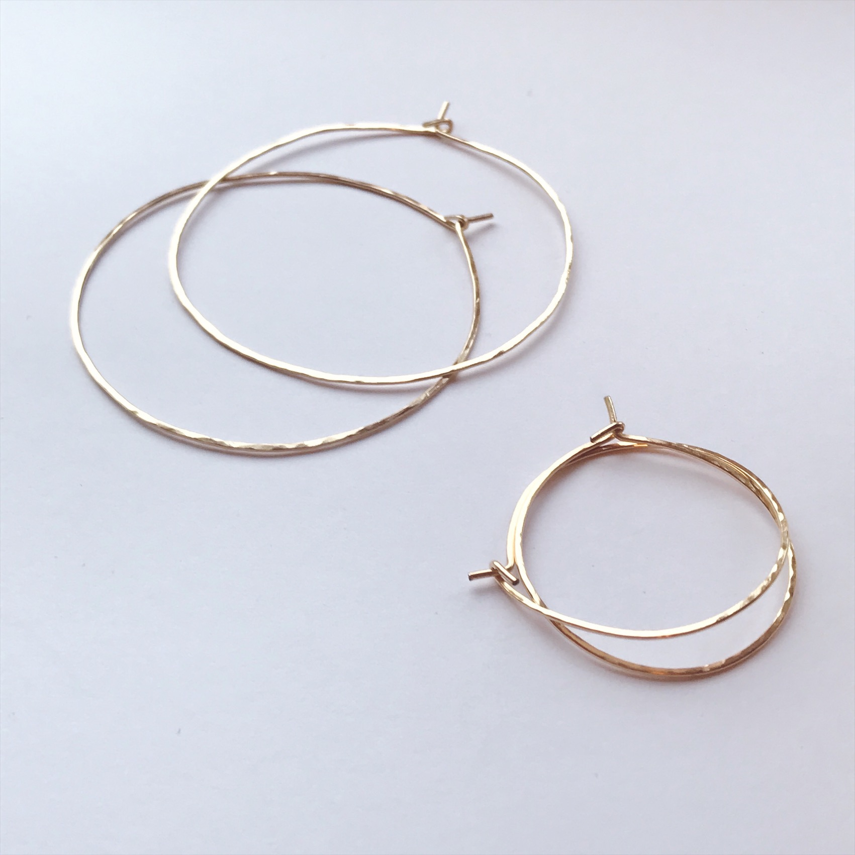 Classic gold hoops with a hammered textured finish created in 14k gold fill   (Top) 2 inch diameter   (bottom) 1 inch diameter