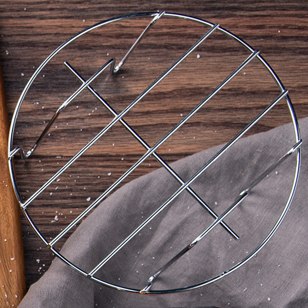 Metal Holder   Excellent for cooking meat and fish. Elevates pans or the Egg Bites Mold, maximizing your cooking surface, and assists in easy removal.