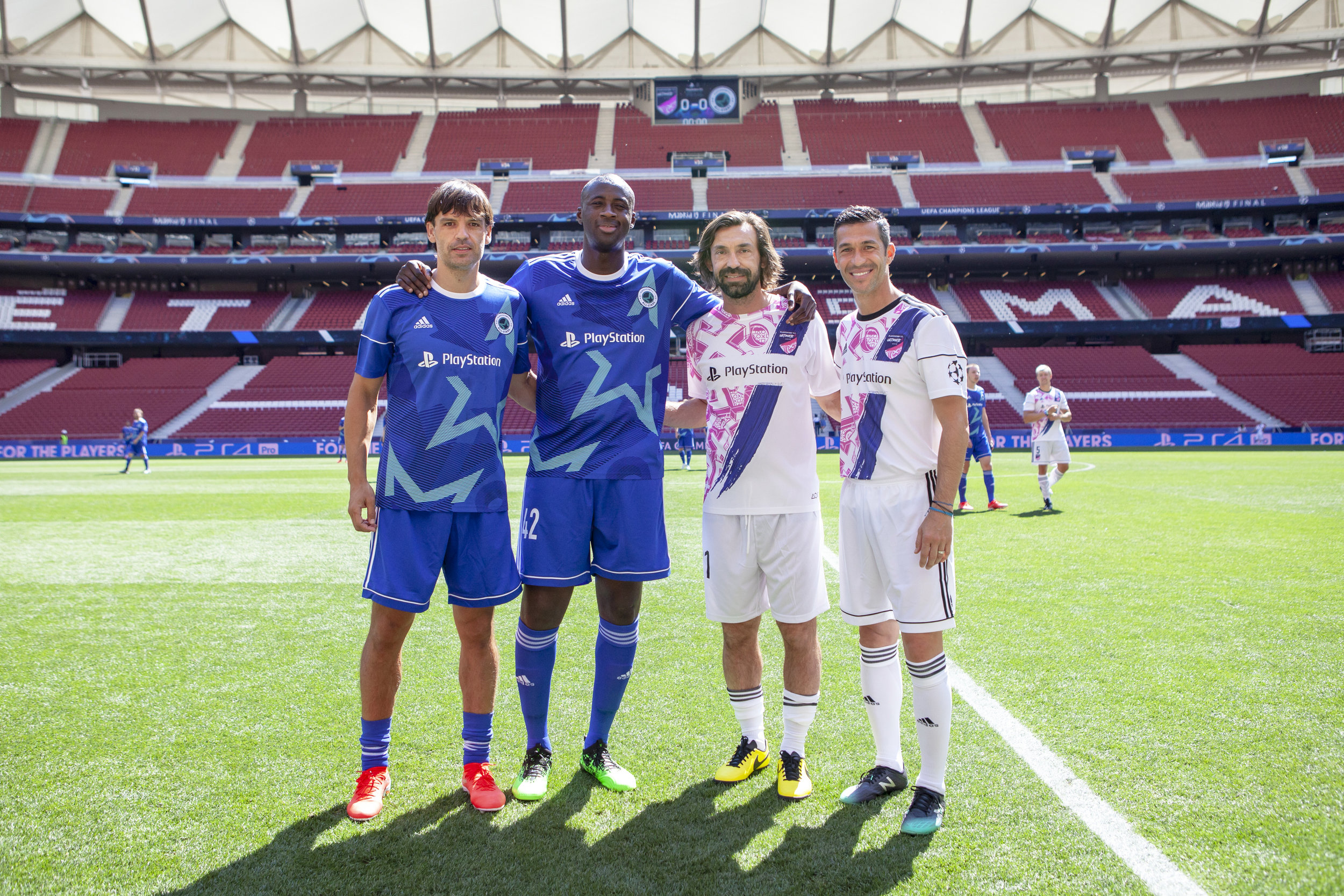 Captain of the All-Stars, Yaya Toure, alongside captain of the Ultimate 11, Andrea Pirlo.