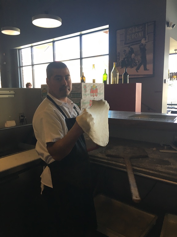 """Jaime, who has been with Dante since the beginning, is almost always at the pizza station. During the warmer months, the bar in front of him is heaped with luscious tomatoes, fragrant basil, or whatever else is in season at that very moment. """"It's been nonstop nettles and sun chokes recently,"""" said Nick when I spoke to him in mid-April. A few days later, the  Facebook page  heralded the season's first asparagus."""