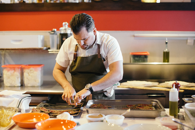 """When chef Nick Strawhecker first opened Dante in 2008, West Omaha diners weren't accustomed to seeing oxtail and pork belly on the menu. """"Now, I'm surprised they don't have oxtail at McDonald's,"""" he laughs. Photo courtesy of Dana Damewood."""