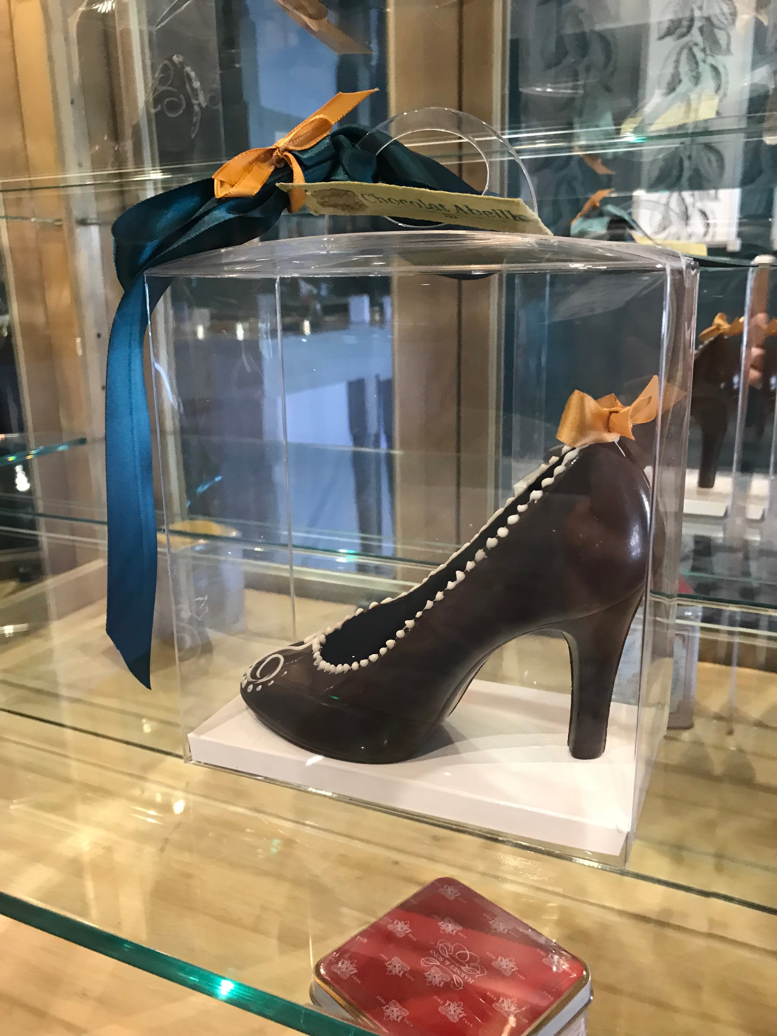 Tina's chocolate shoes have long been a favorite of Omaha's smart set.