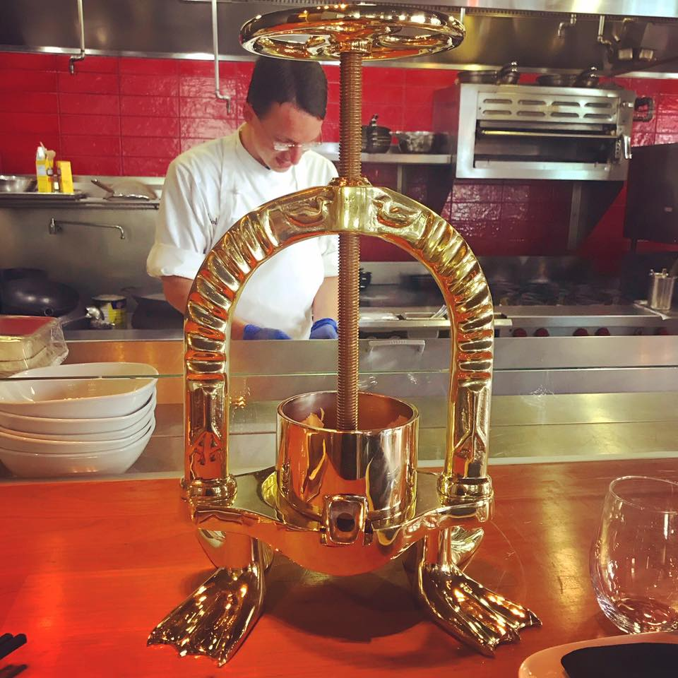 LeRoux's gold-plated duck press — a rather baroque component of beak-to-tail food prep — was a gift from Xavier LeRoux, one of Chef Lon Symensma's mentors and the restaurant's namesake. (photo courtesy of ChoLon)