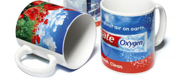 "Full-color sublimation mugs for Colgate toothpaste product boasts the marketing message ""The freshest air on earth"" with wrap around imaging utilizing a large overall imprint area."