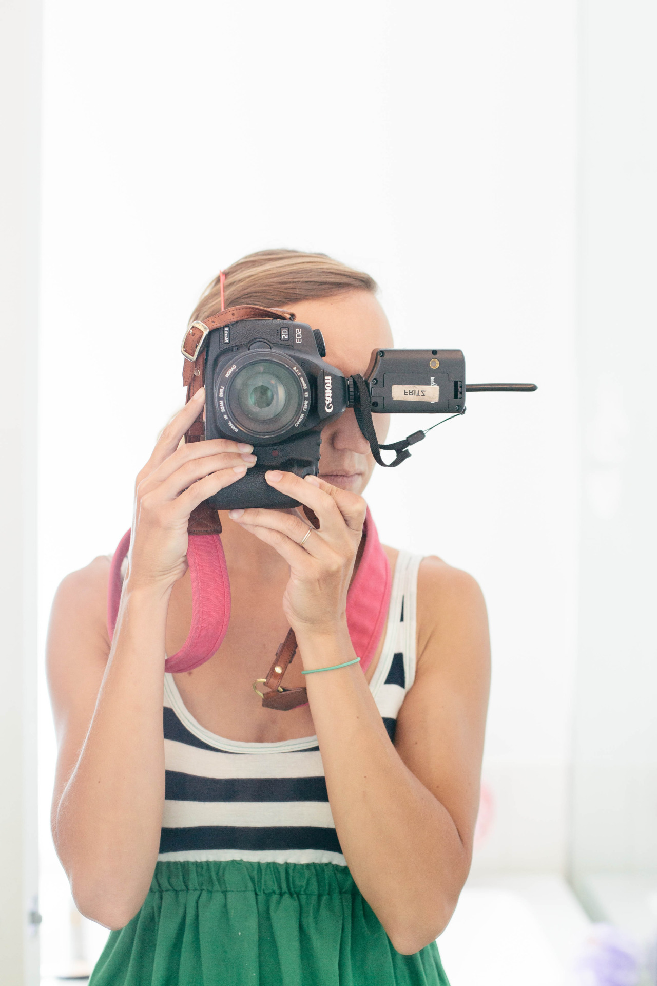 Self portrait in a clients' bathroom.   // camera strap from  fotostrap