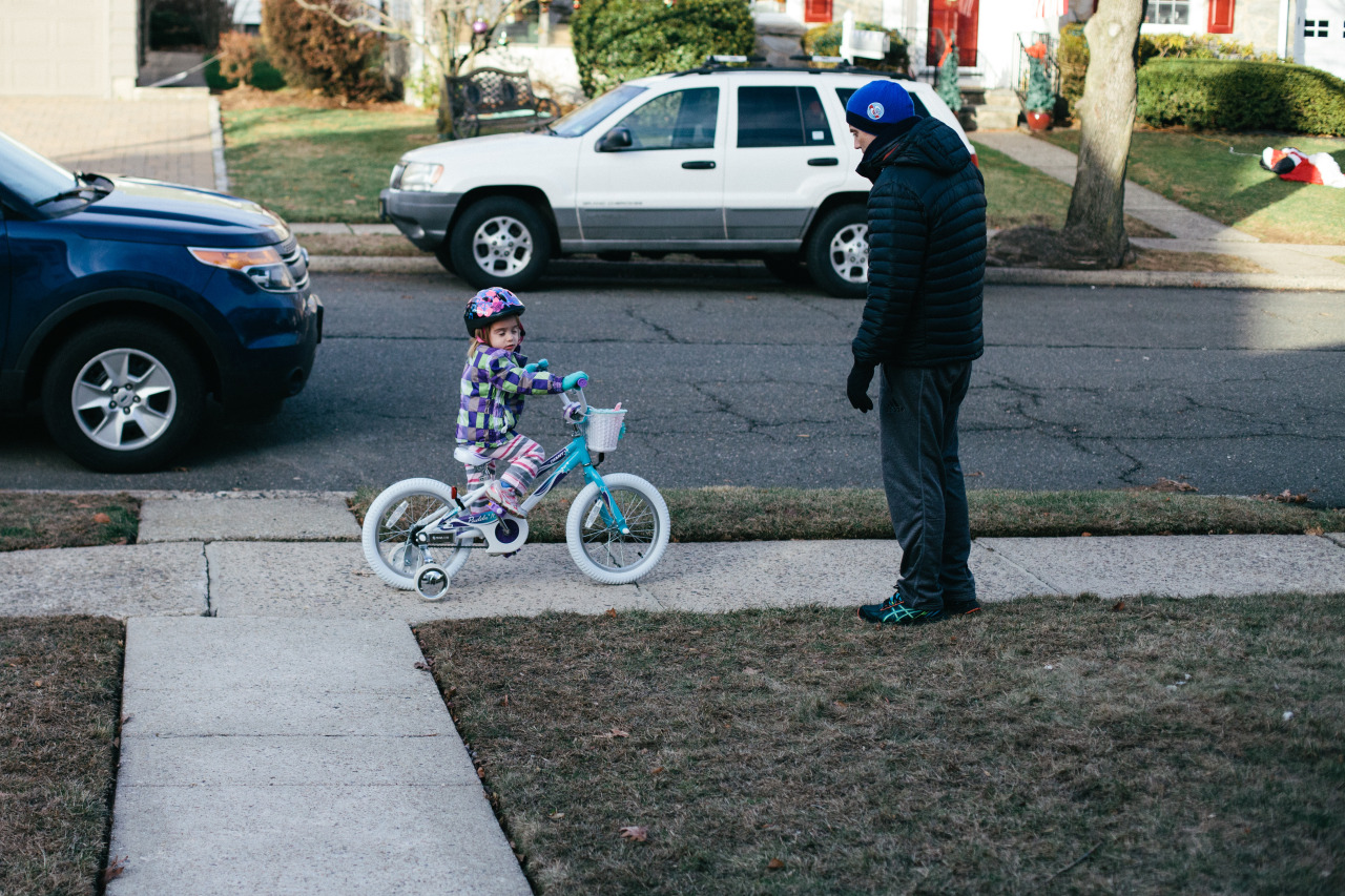 She sat there for five minutes refusing to pedal, but once she started rolling she refused to stop and out-pedaled her older sister much to her chagrin.   Bloomfield, NJ. December 2013.