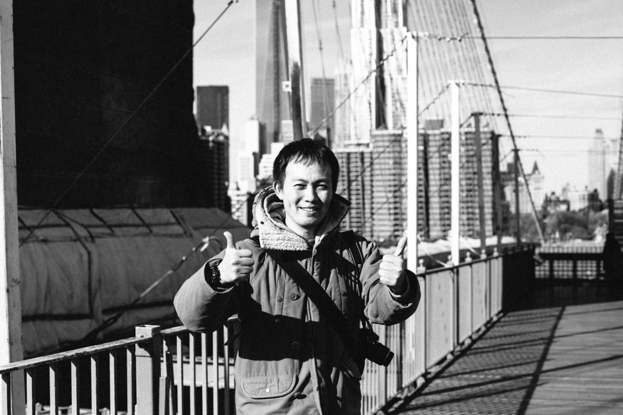 This is  Taka , we met him while doing our On a Wednesday interviews last week. He was quite charming and emailed this after returning home to Japan.     Hi Bekka!   It' Taka, a japanese you met on the Brooklyn bridge Wednesday last week.   I hope you remember me and also that you took some pictures of me there.   Now I'm back to Tokyo.   I see your weblog and find what a wonderful photographer I got accquainted with,and how lucky I was to get you to take those pictures.   They remind me of my travel in NY and make me happy.   Your weblog is filled with a lots of beautifully designed photos, isn't it?   As I love designation, I love your weblog also.   Since I went to NY in order to be inspired by lots of intersting things,   I can't help appreciating the great meeting you on that bridge I really wanted to visit.   Any way I'd like to express my appreciation to you.   and I'd appreciate it if I could keep touch in with you.   Best regards.   Taka.   P.S.   I'll frame photos you took.     That was a day-maker right there.