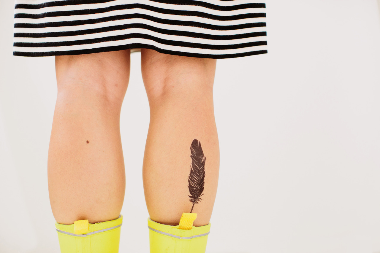 Possibly my new favorite Tattly (also those are my legs)!    everypixel :      Feather  by Jen Mussari, photo by Julia Robbs for Tattly.com