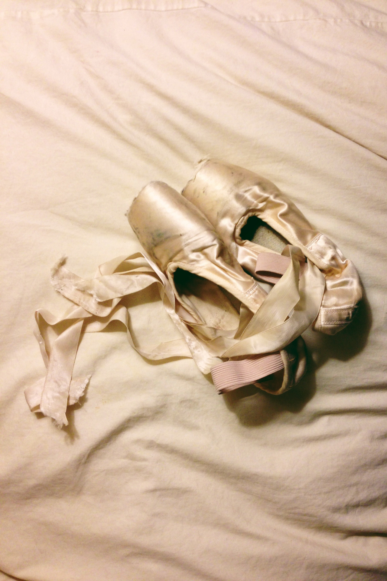After watching   First Position   (it's on netflix instant) this evening I just had to dig my old pointe shoes out from under my bed. (I might have worn them for the remainder of the movie.)