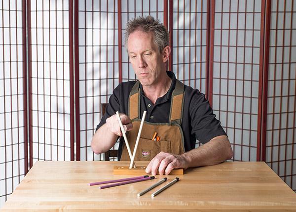 Using ceramic sharpening rods, set at the proper angle.