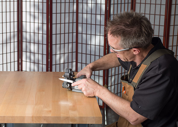 The sanding belts I use move at relatively low speeds to keep from over-heating the blade.