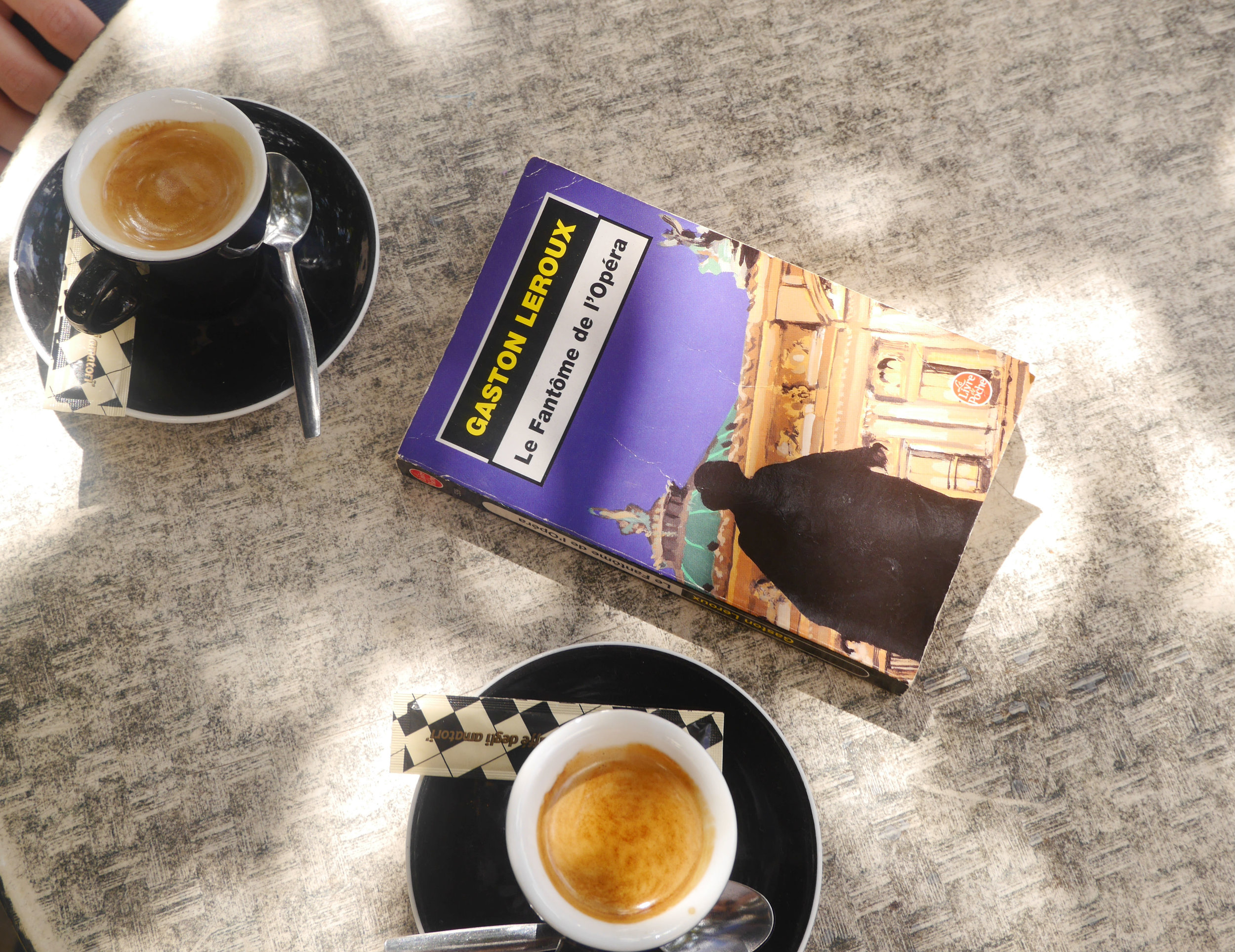 Coffee and a book found in the street, somewhere near Pere Lachasise.