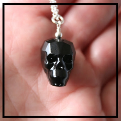 Keep classy and slightly gothic with this sterling silver crystal skull necklace.