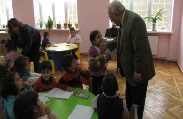 TCA Central Board President Edmond Y. Azadian, visiting school children in 2014