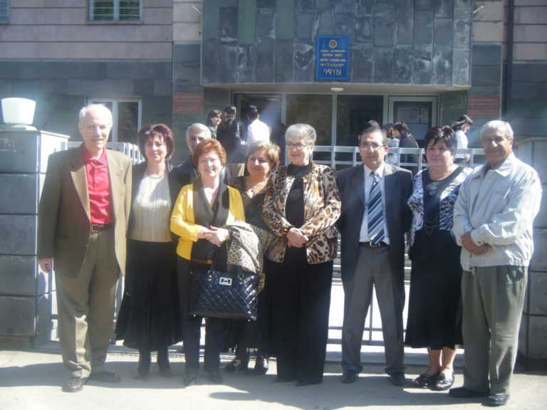 Principal of Vahan Tekeyan School No. 2 of Gyumri, Hovhannes Bedrosian (third from right), is surrounded by guests at the entrance of the school. 2009.