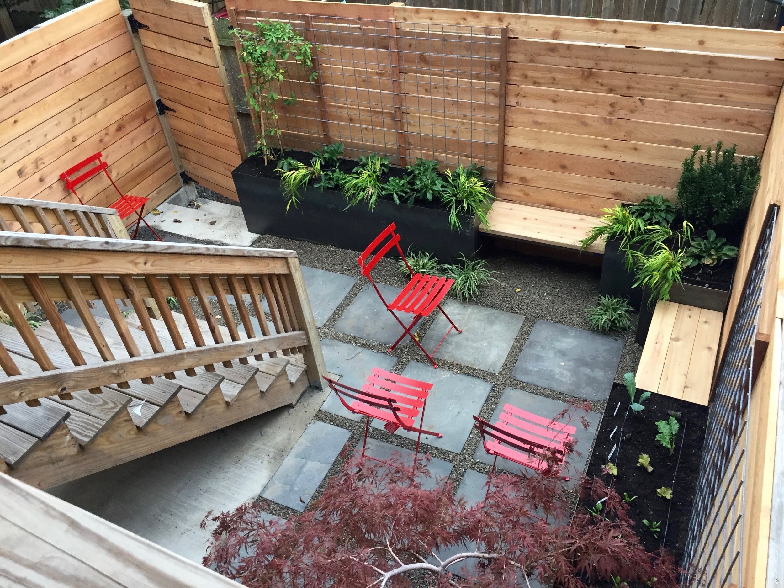 Steel planters with floating cedar benches   Backyard design (and photos) by Love & Carrots