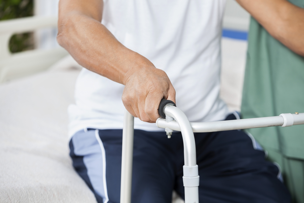 Midsection Of Patient With Walker In Rehab Center