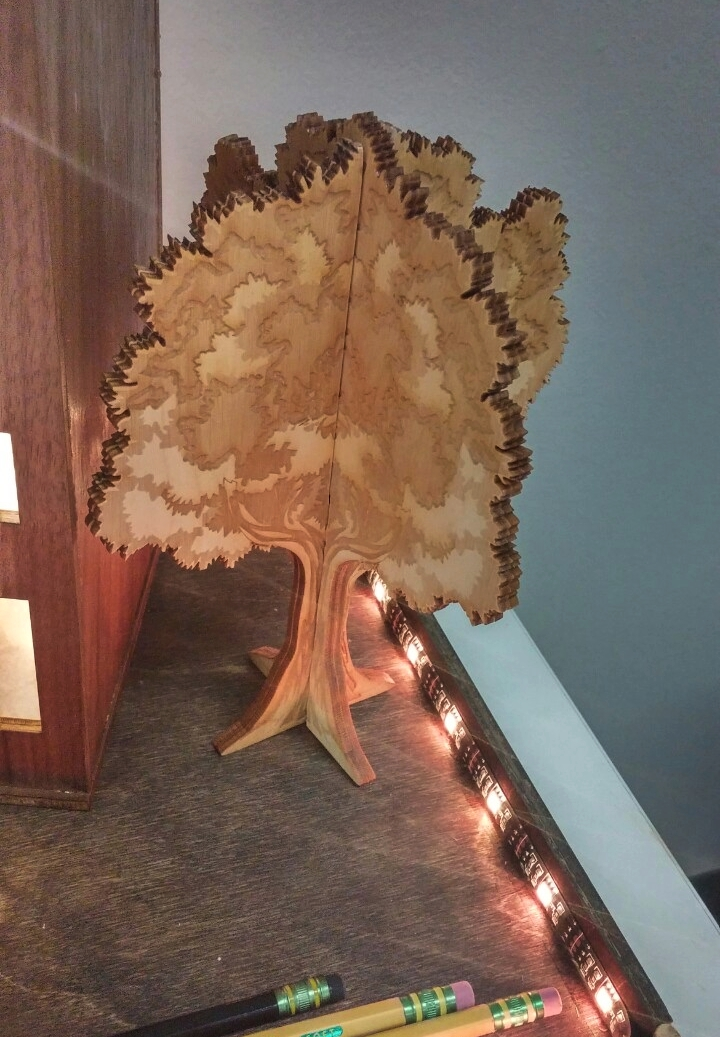 Combination of four  laser cut trees  (Mirror glued and puzzle fitted).
