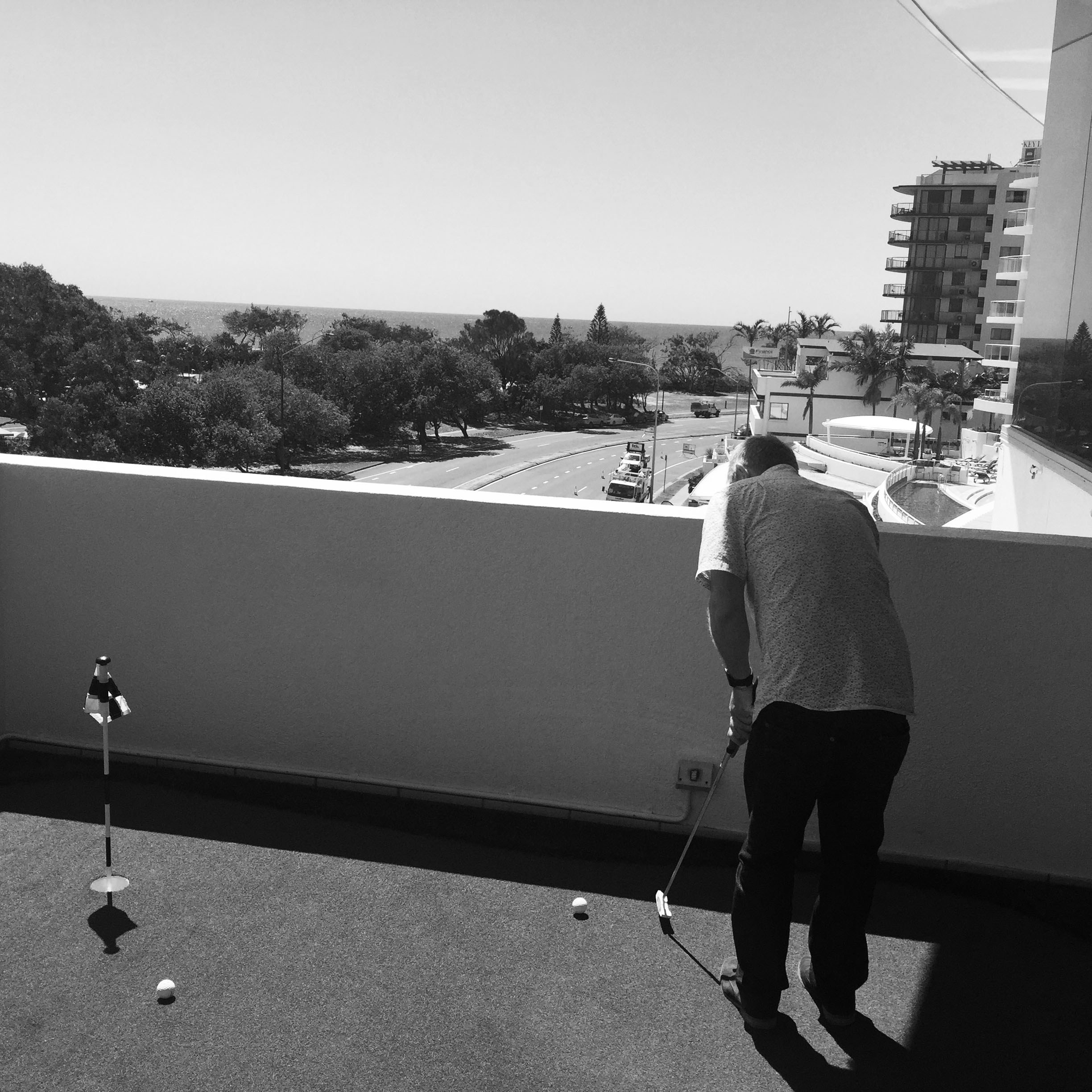 Inbox 2.0   Director Phil Jackson testing out the Putt Putt green overlooking the ocean