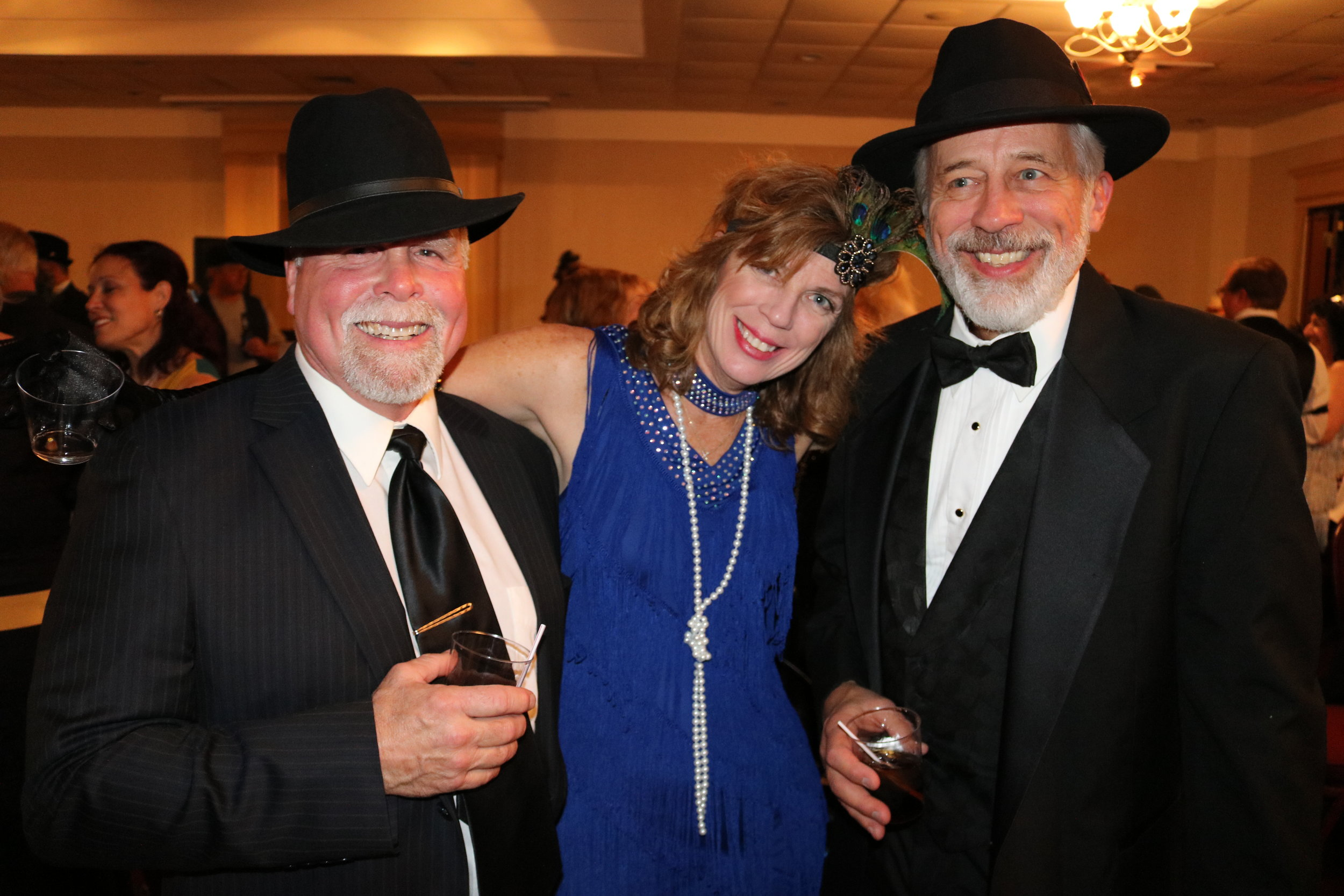 All kinds of trouble showed up for this party. Rabble rousers James Altherr, Wanda Weiman, and Mike Petsch are caught in the act.