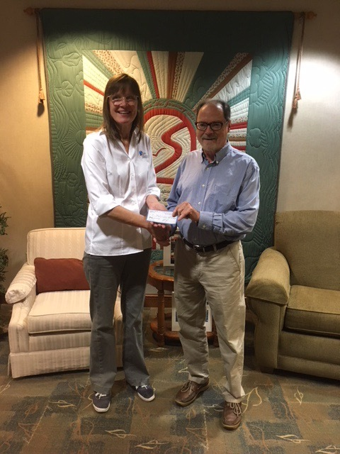 VC Harvey Rickert presented the Chief Operating Officer of Stein Hospice, Tamara Zuilhof, with the funds raised from HBYC's Race in the Bay for Stein Hospice and social.