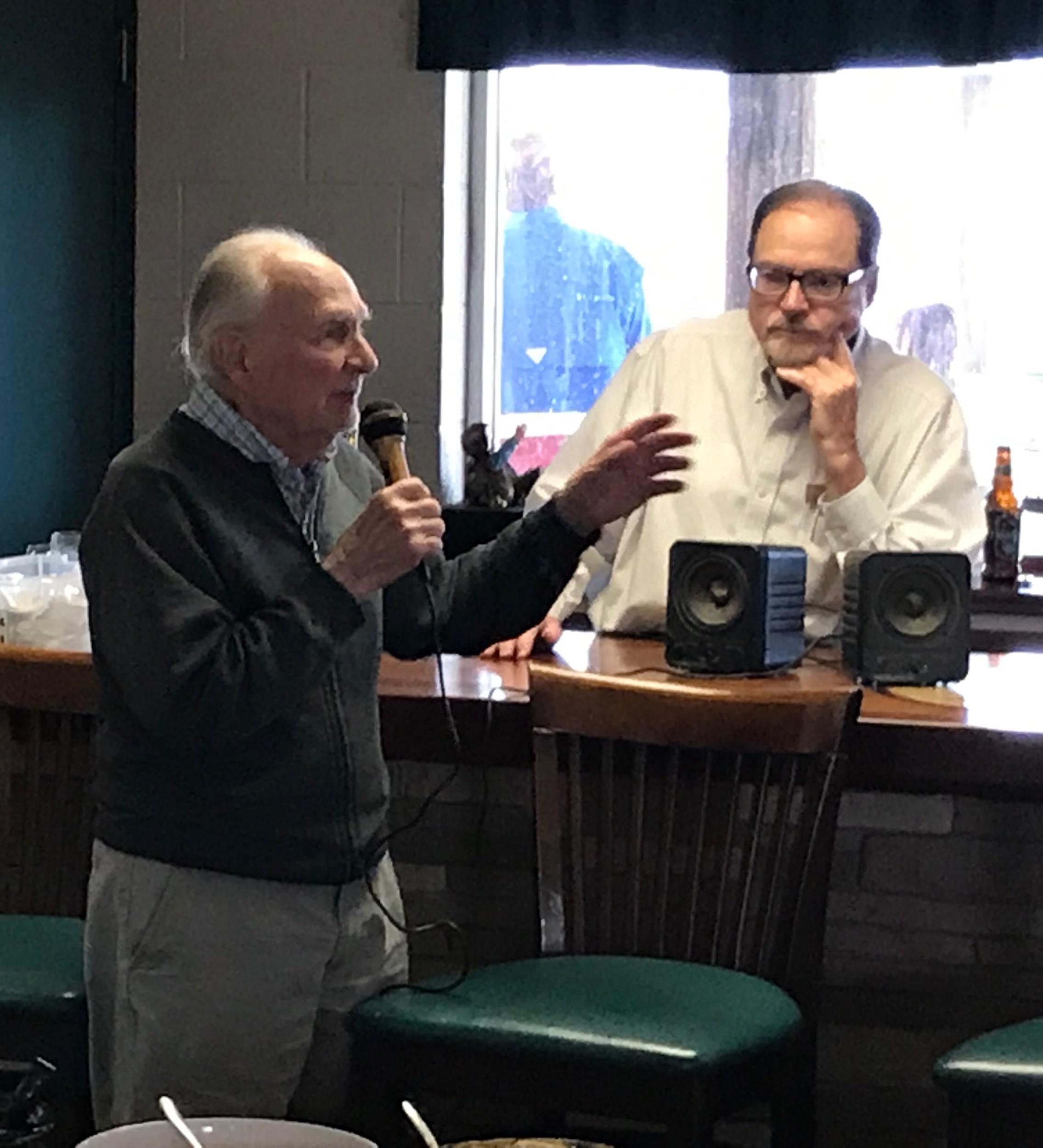 Commodore Harvey Rickert listens as Bob Reynold's discuss his grandfather Scott Mathews.