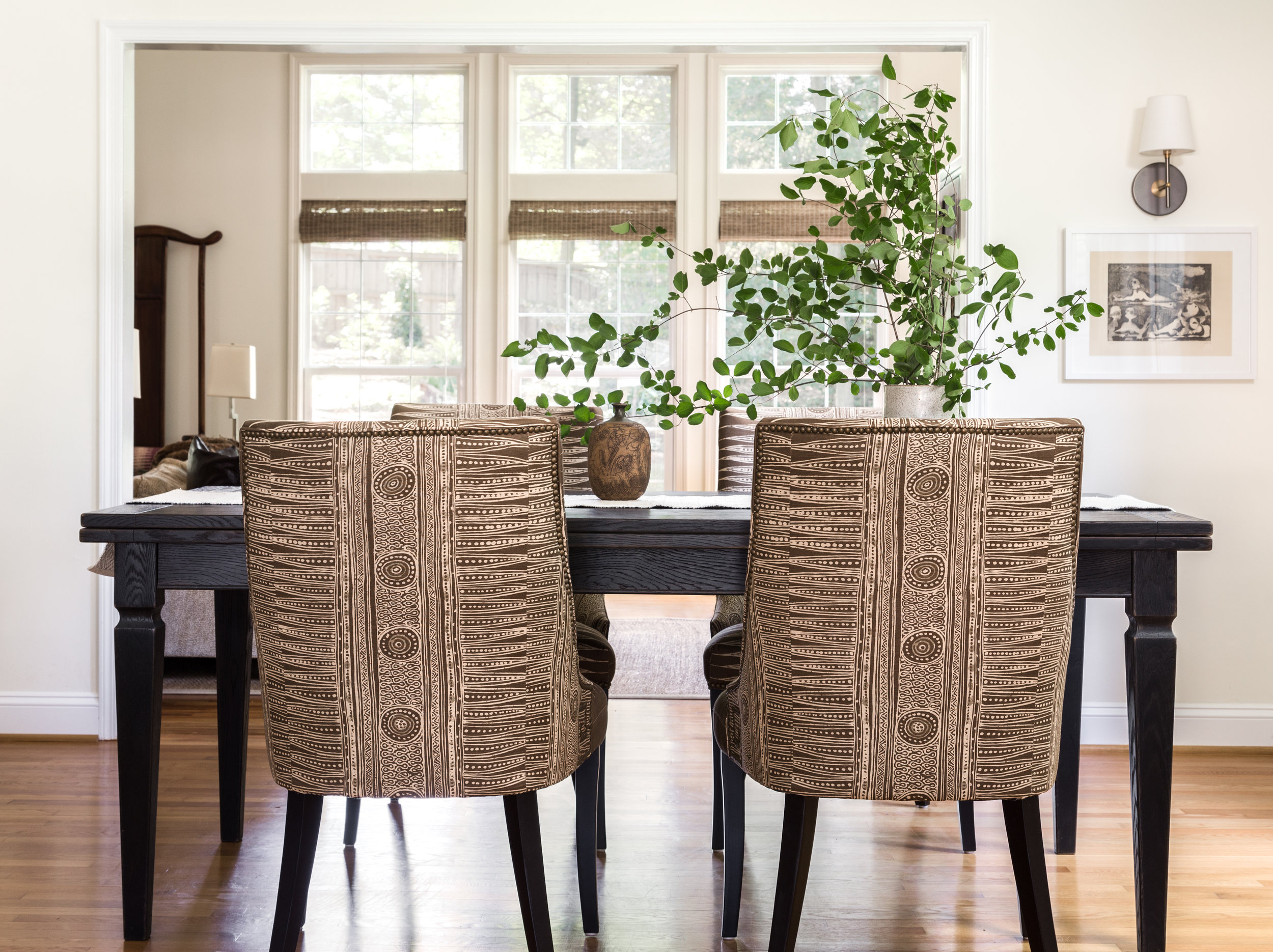 Custom dining chairs covered in a fabulous ethnic print are the centerpiece of the dining area.