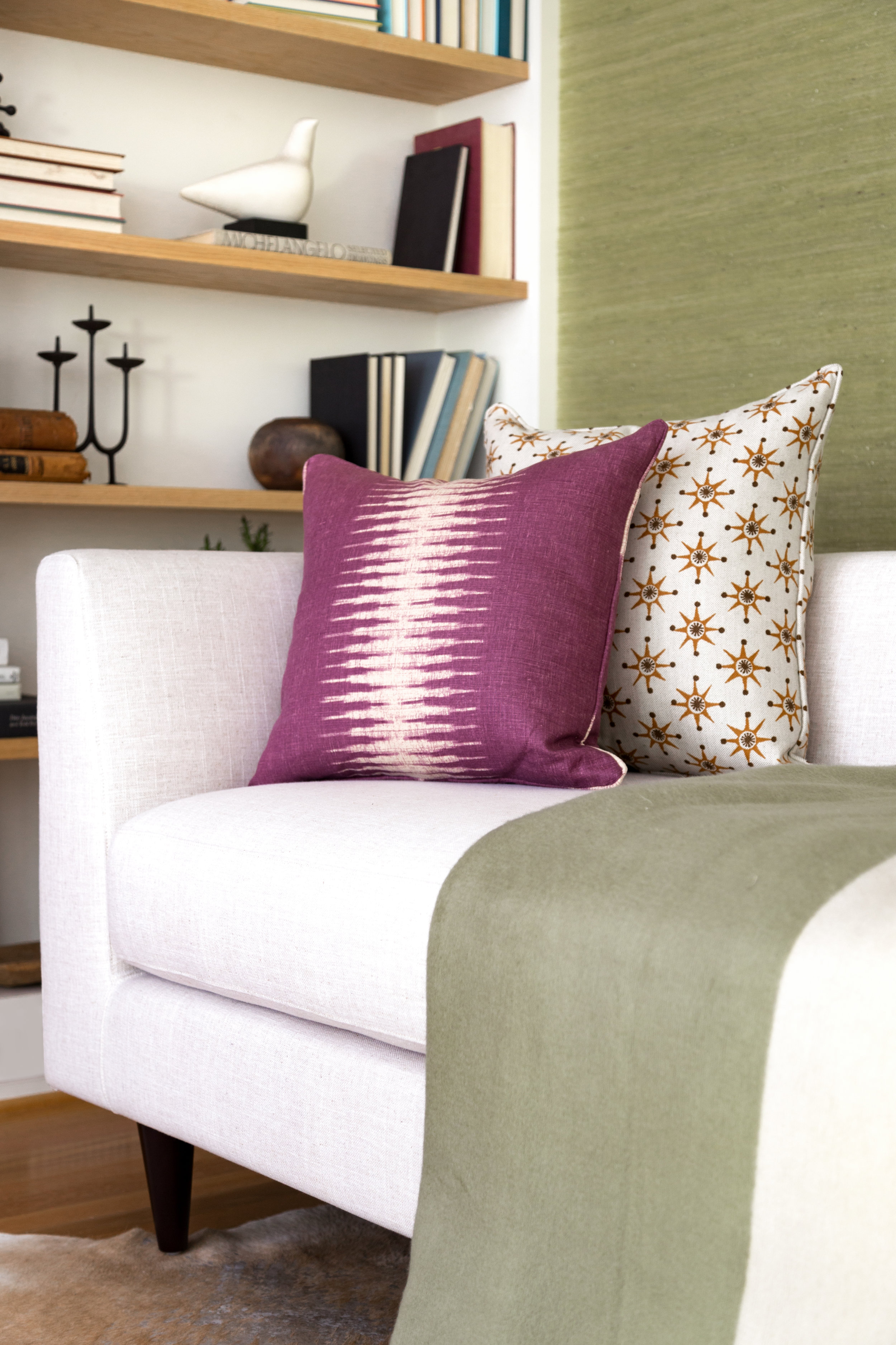 Beautiful custom pillows bring focus against a neutral backdrop.