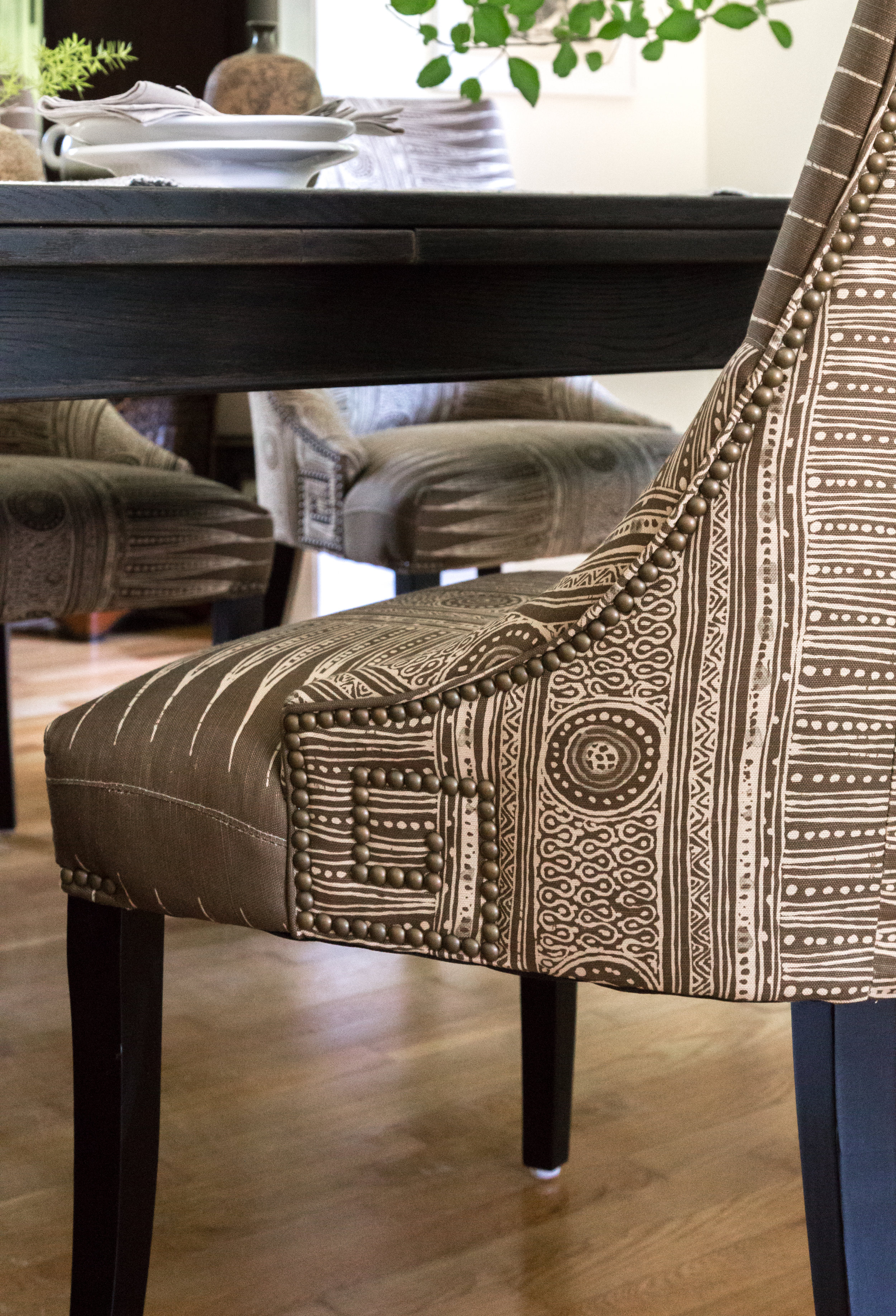 Beautiful nailhead detail on custom dining chairs.