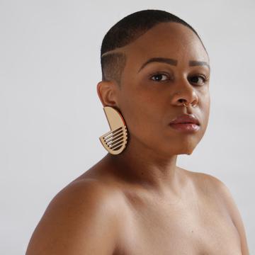 """Taja modeling her """"Ninety"""" earrings."""
