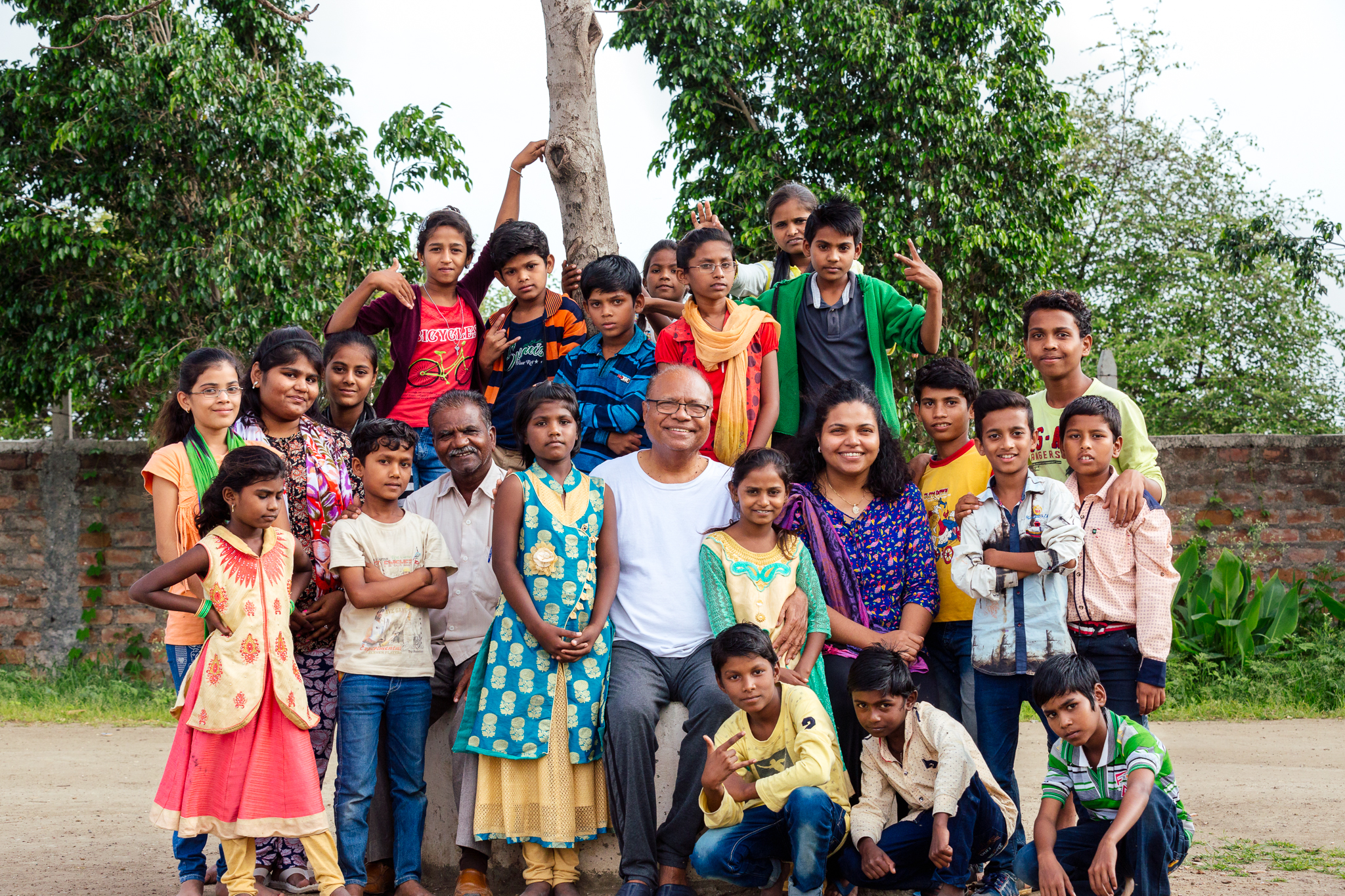 A group photo of a lot of the kids from the orphanage and the man who started it in the 90s. He was inspired to start a school and an orphanage with his wife after being orphaned at 6 and growing up in boarding schools in India