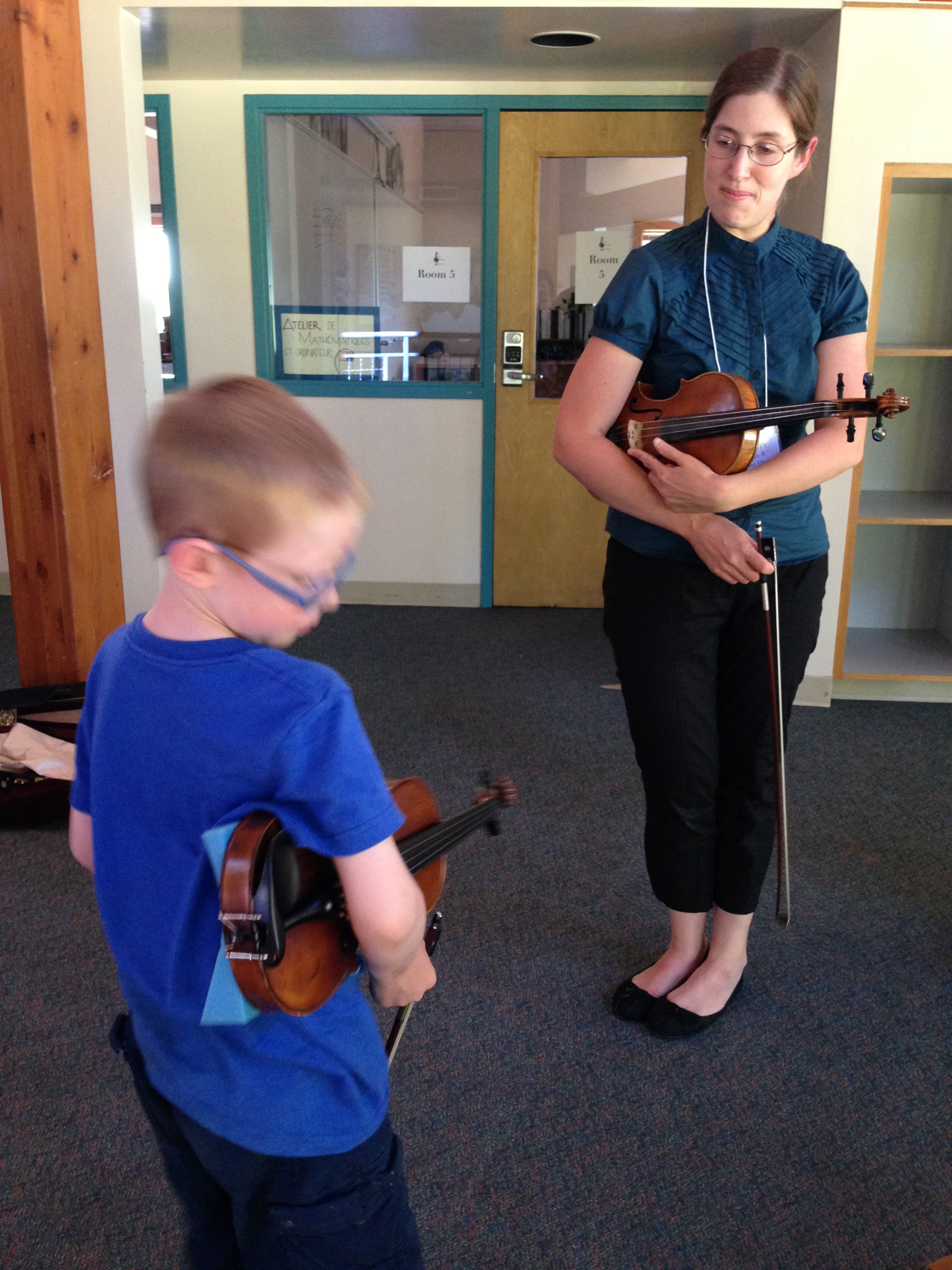 "Working on ""rest position"" with a violin student."