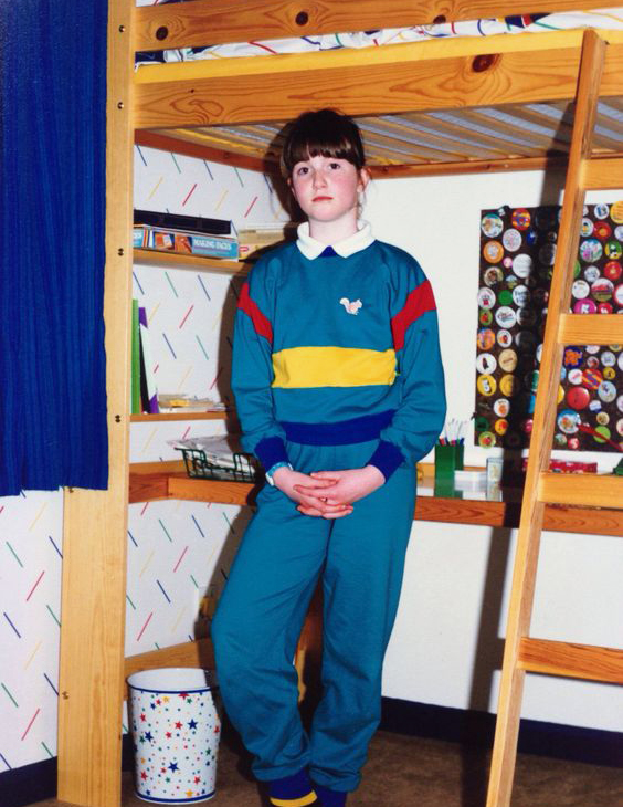 My sister in her bedroom, c.1988 (she'd moved on from the green, but was obviously enjoying the tracksuit!)