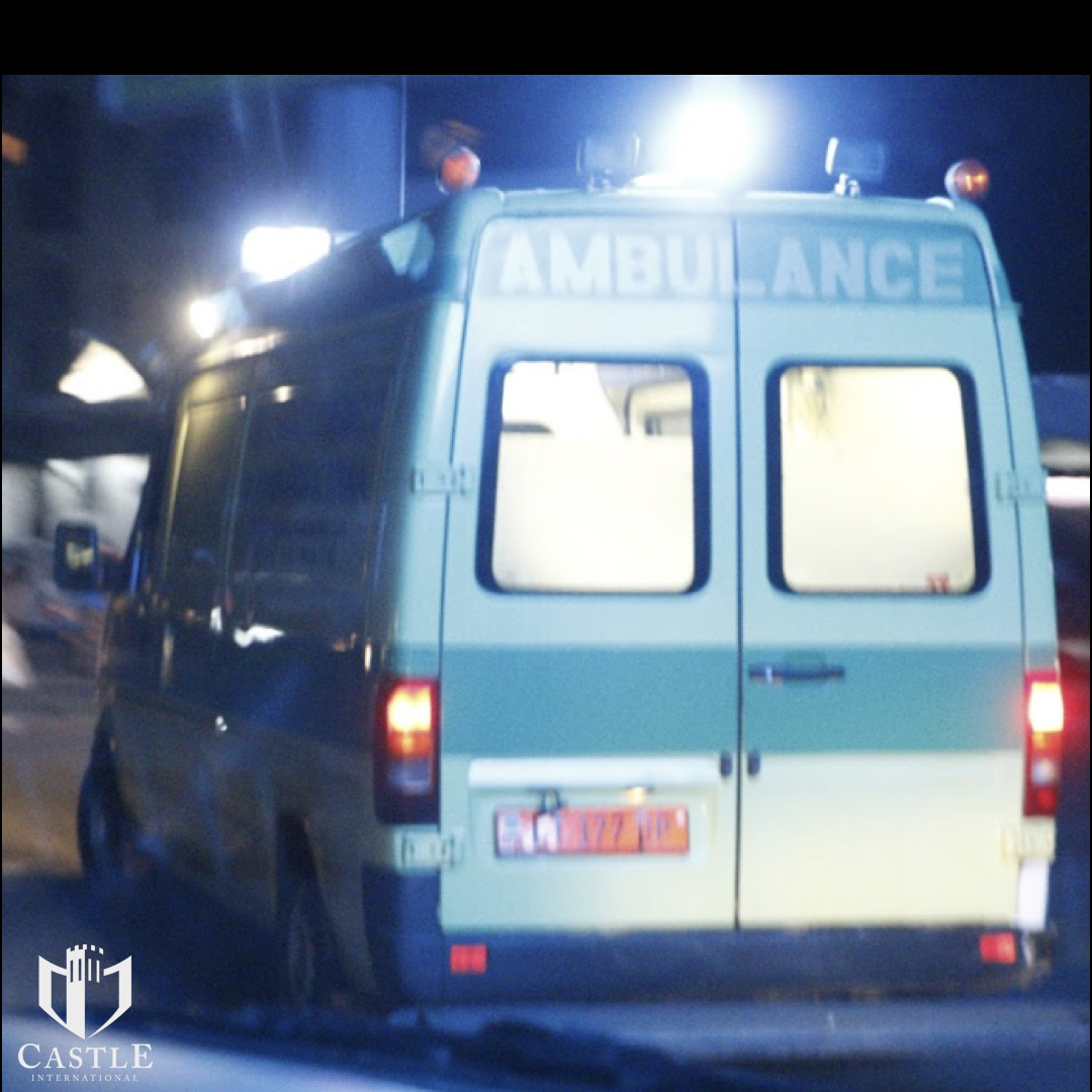 The ambulance we secured for the transport races us to the hospital in the middle of the night.