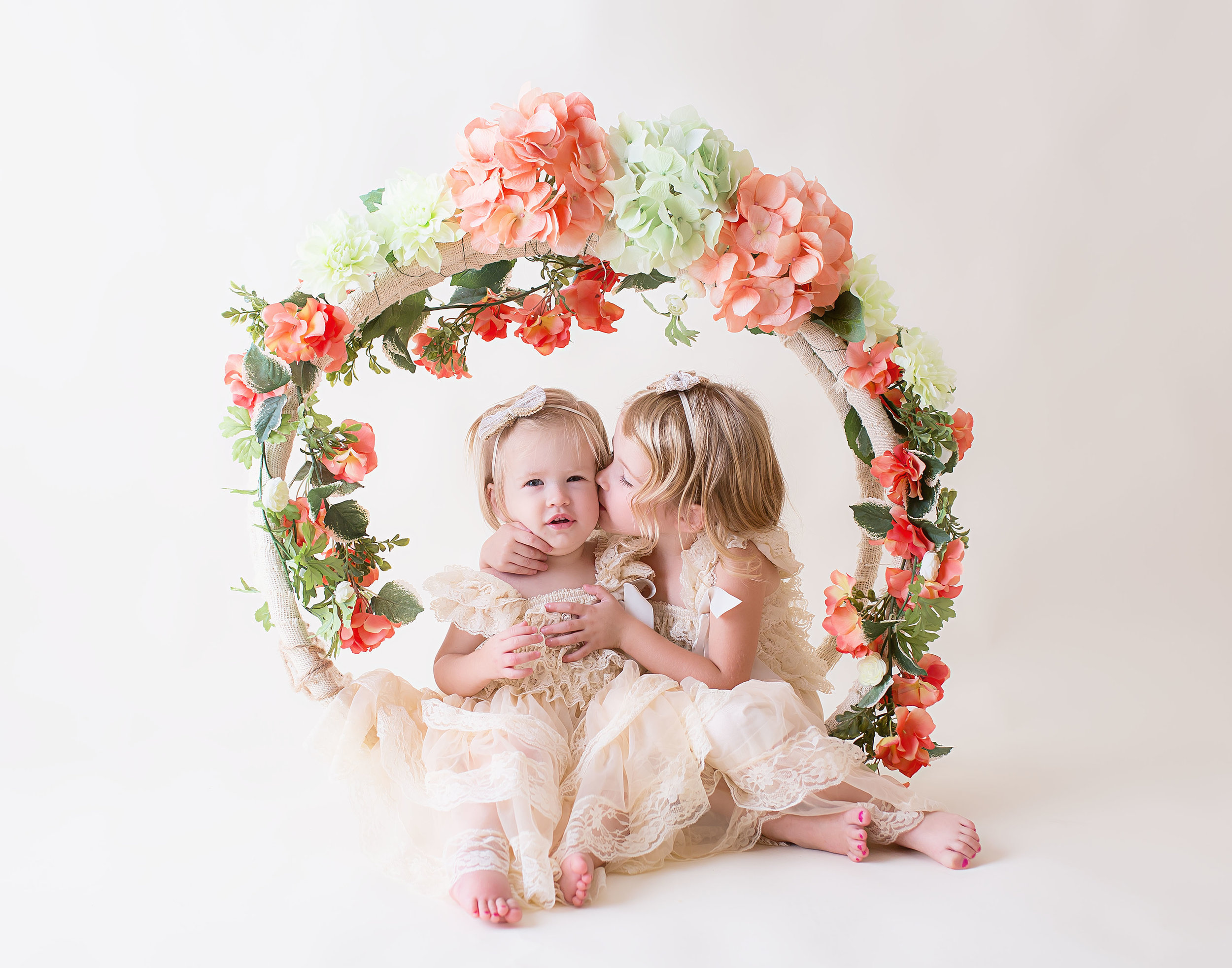 Leigh-Ann - I am thrilled with our experience! We had a quick session which is perfect for my busy toddlers. The pictures were bright and fun! The girls love Melissa and I love the pictures!