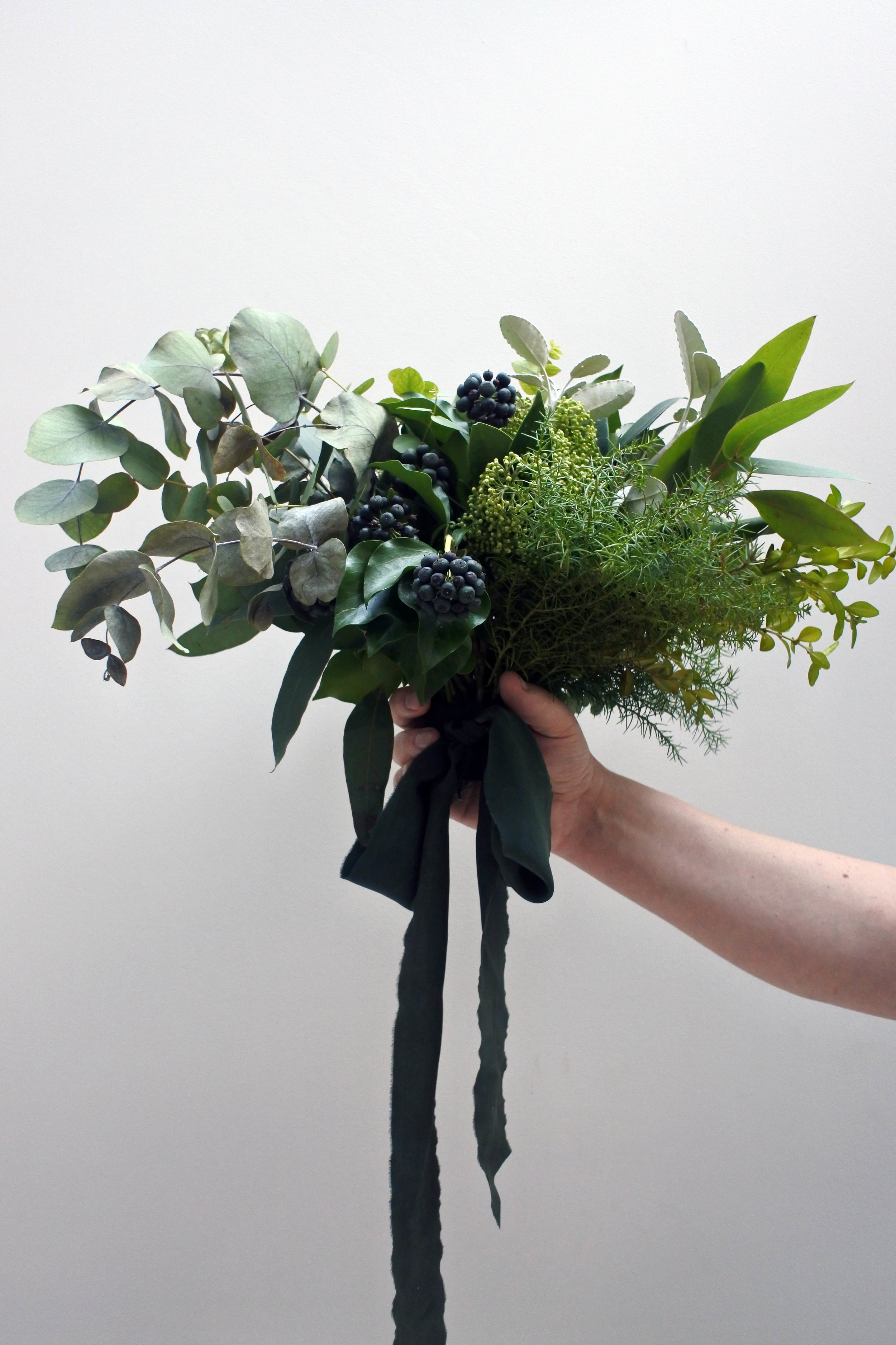 Man Bouquet by: Honeysuckle and Hilda  Ribbon by: Susanna Luck  Photo by: Claire Bowen