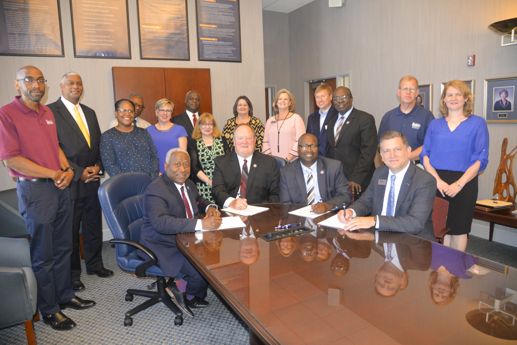 SC State Bridge Signing - Officials from SC State University and Piedmont Technical College gather in Greenwood for the signing of the articulation agreement on May 1, 2018.