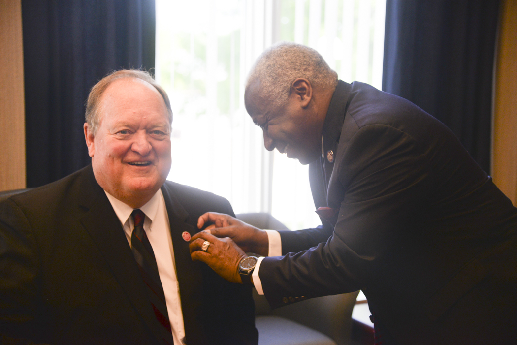 James Clark pins an SC State pin on lapel of Ray Brooks.JPG