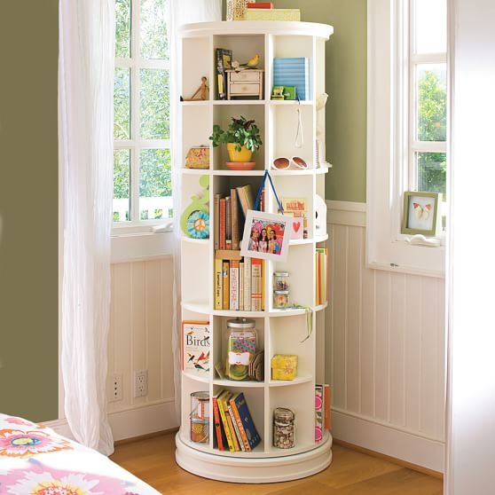 REVOLVING CAROUSEL BOOKCASE - Perfect for a small room or office! Add it to an unused corner of a kids room, or make the focal point in a pediatric doctors office.