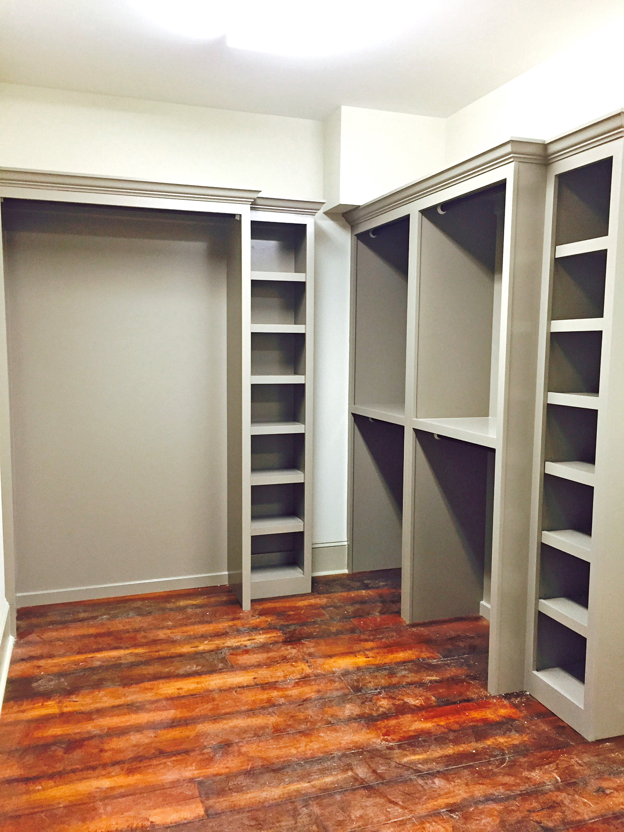 Walk-In Closet with Long Hang, Double Hang, Cubbies, and Crown