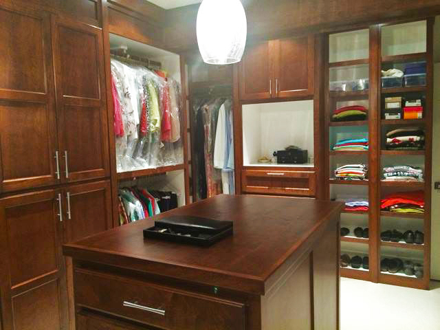 Stained Master Closet Painted Interior, Enclosed Bottoms, Crown & Header Detail, Shaker Doors, Open Cubbies, Hanging, and Island with Drawers