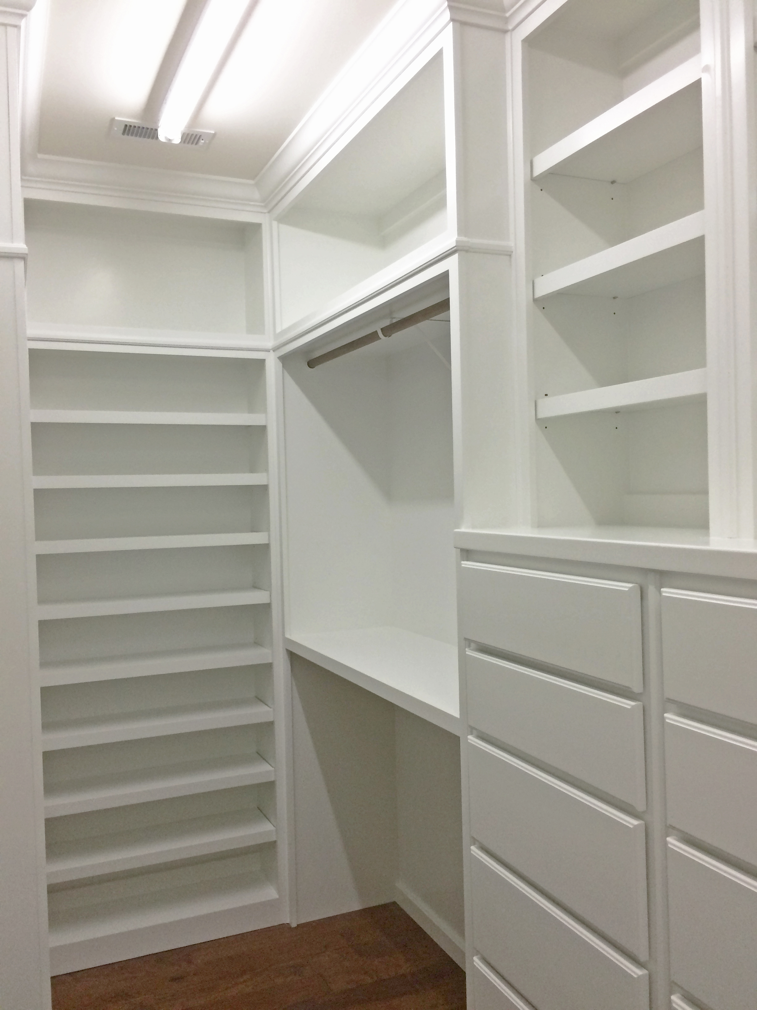 Master Closet with Long Hang & Double Hang with Shelf Above, Adjustable Shelves, Open Cubbies, Slab Drawers, and Crown